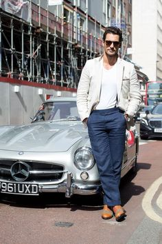 David Gandy Wearing Beige Blazer, Whte V-neck T-shirt, Black Suspender, Navy Dress Pants and a pair of Tan Leather Oxford Shoes