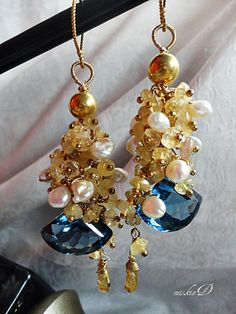 Hand cut Golden Citrine clustering around fancy cut London Blue Topaz, with South Sea Thailand pearl and Gold Vermeil brings luxury to the creation. https://www.etsy.com/listing/159041038/blue-topaz-earrings-citrine-cluster?ref=shop_home_active