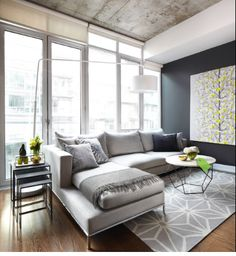 love this condo's living room, but with different colors. I actually think this may be the same condo clay and I got :/ the floors, the windows, the concrete ceiling... it's all looking too familiar lol