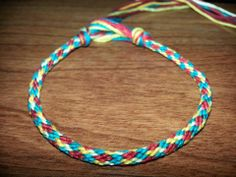 12 strand kumihimo bracelet; red, teal and yellow