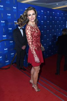 Elizabeth Hurley sexy legs in a red and nude dress with gold high heels at People Style Awards in Munich