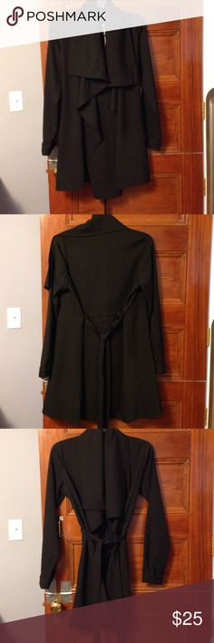 NWT black stylish Duster. Small. Waterfall front. In style black waterfall Duster. So cute! Thin pure black polyester material. New with tags. Full disclosure there was an issue with one of the straps pulling out in the back but it has been repaired. Otherwise perfect condition! Never worn. Jackets & Coats Trench Coats