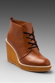 25 Pieces That Have Us Pumped For Fall - Marc By Marc Jacobs Wedge Lace Up Booties, $328, available at Shopbop. LOVE THESE.