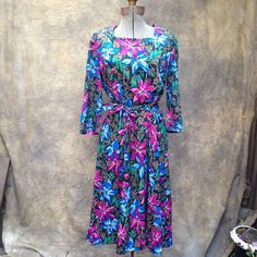 """Vintage 1980s Floral Dress // Bright Bold Flowers, Belted, Square neckline. Belted and a square neckline: ready for fun!   Details Size: 8 Shoulders: 15"""" Sleeve: 17"""" Waist: 26"""" - 30"""" Hips: free Skirt Length: 19.5"""" Overall Length: 37""""  Brand: Three R's Colors: pink, white, blue, green, brown & black"""