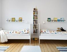 Great Idea for book shelves.. ledge and bar (maybe a kitchen rail?)