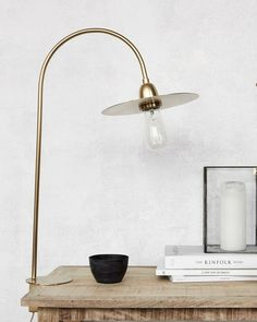 Update your home interior with this Glow table lamp from House Doctor. Wonderfully crafted from brass, this lamp is modern in design and features a gold coloured disc above the bulb which is exposed. Brass Table Lamps, Brass Lamp, Desk Lamp, Lampe Decoration, Decoration Design, House Doctor Lampe, Glow Table, Glow Lamp, Lampe Retro