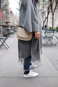ACNE STUDIOS Poncho / MANSUR GAVRIEL Bag / CITIZENS OF HUMANITY Jeans / KAT KIM Rings / ADIDAS Sneakers