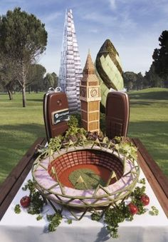 Barclays have commissioned artist Carl Warner to build several London landmarks from out-of-date food: a Shard of bass, an Olympic stadium of green beans and cocktail sausages, a pretzelly Big Ben and a Gherkin made of melons (not gherkins).