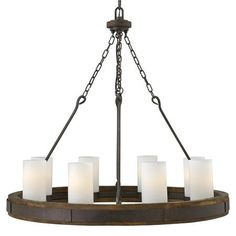 """$1200 Bold Rustic Iron Chandelier - Bold Rustic Iron Chandelier - Large A blend of rustic iron and over scaled glass cylinders create this sophisticated vintage style chandelier. The rich wood frame and forged iron ring hangs from bold """"s"""" hooks that transition into chain. This vintage rustic style works well with modern lodge and industrial chic interiors. 8x100 watt medium base lamps max. (35.5""""Hx38""""W) Supplied with 12' of wire and 10' of chain and 5.25"""" round canopy."""