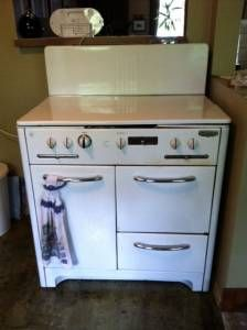 Wedgewood gas stove, with fold-down cover for the burners. I used to have one just like this. I loved it.
