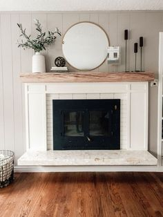 This project is sponsored by Love The Room and Lowe s Yesterday Chris and I tackled another quick easy and inexpensive before and after project at our friends home The fireplace in their living room the focal point needed Home Fireplace, Fireplace Remodel, Fireplace Design, Over Fireplace Decor, White Fireplace Mantels, Wood Mantle Fireplace, Fireplace Makeovers, Decorative Fireplace, Fireplace Surrounds