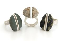 Andrea Williams: Kyuma Split Rings. Kyuma is the Tibetan word for magic. The stones appear to float, divided, on a finger. Beach stone and reclaimed Sterling. http://www.boundearth.com/