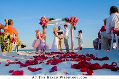 One of our new beach wedding setups pink and white on our newest bamboo wedding arch.