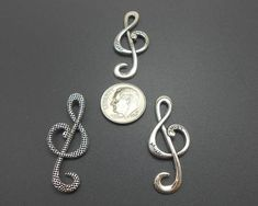 8 Large Treble Clef Charms These have music inscribed on them. Antiqued Silvertone metal 37x15MM The metal is a zinc alloy metal that is lead free and tarnish resistant. These are great embellishments for all of your crafting and jewelry making projects including necklace pendants, earrings, charm Music Jewelry, Treble Clef, Jewelry Making, Pendants, Charmed, Pendant Necklace, Beads, Antiques, Unique Jewelry