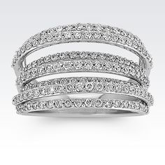 One hundred and fifty round diamonds, at approximately .98 carat total weight, brightly sparkle in this fashionable ring. The lines of diamonds are staggered in height creating a lovely and unique design. This ring is crafted of quality 14 karat white gold.