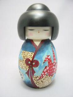 Kokeshi Japanese doll  I have a kokeshi phone charm. :)