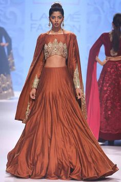 Rust brown temple embroidered lehenga set available only at Pernia's Pop Up Shop.