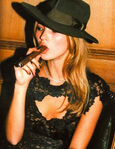 Kate Moss smoking a cigar at the launch of Prada's 24-hour museum in Paris (2012)