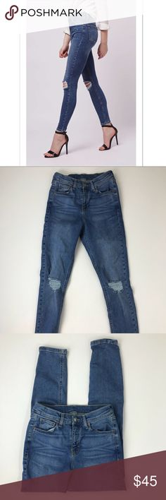 """Topshop Moto Jamie Distressed Skinny Jeans Super cute! Brand tag fell off as shown in pics. W28L32 Runs small Approximate measurements: Length - 37"""" Inseam - 27"""" Waist - 12"""" across 9"""" front rise    92% cotton // 5% Elastomultiester // 3% elastane   🏷TOP012-2017 Topshop Jeans Skinny"""