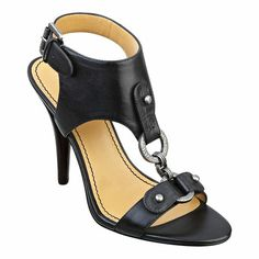 "As seen in the pages of Glamor and O, The Oprah Magazine .....Single sole t-strap 4"" sandal with metal hardware detail.  Adjustable ankle strap.  Leather upper."