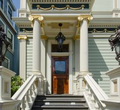 The Victorian features a portico flanked by gilded columns.