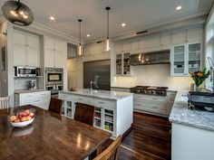 Kitchen with White and Brown Cabinets & Two Sinks : Designers' Portfolio : HGTV - Home & Garden Television