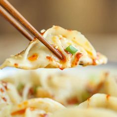 Make-ahead, freezer-friendly dumplings made completely from scratch with an optional hot chili oil sauce for a kick of heat!