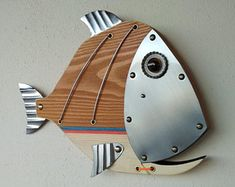 Fish made with Wood, Metal,Glass, Handmade by Unikos Arts Give your wall a upcycled beach steampunk theme with one of a kind original distressed Fish wall art sculpture. Wood Fish, Metal Fish, Fish Wall Art, Fish Art, Fish Fish, Fish Sculpture, Wall Sculptures, Nautical Art, Recycled Art