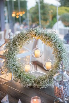 Romantic elegant wedding decoration with baby's breath wreath and candles at Alsos Nimfon Babys Breath Wreath, Wedding Decorations, Table Decorations, Baby's Breath, Elegant Wedding, Romantic, Wreaths, Candles, Home Decor
