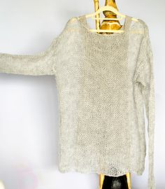 Mohair women sweater in light gray with long sleeves.For casual and everyday usage, made loose fit,will go perfect with jeans and may combine easily with many colors.  Material : mohair,wool and acrylic mixed yarn.  Available sizes and approx. measurements for the sweater;  Extra Large (XL) Bust: 44 Widht / Hip : 44 Length: 28 Sleeves: 29  *I recommend all handmade products to be washed gently by hand in cold or warm water with a mild detergent and be laid flat to dry for a longer usage....