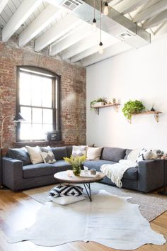 """Getting an ample sofa was on the top of the priority list. Reed is a tall guy (6' 4"""" to be exact), so they went with a large West Elm sectional."""