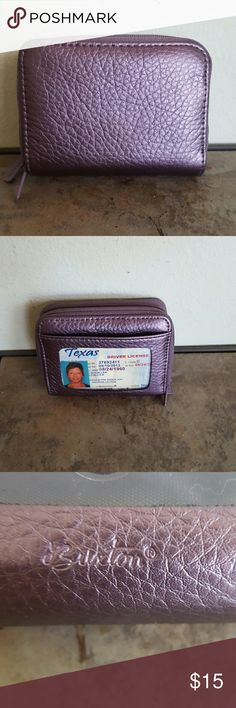 Buxton Purple Metallic Leather Credit Card Wallet Measures 4 x 3 x 1.5.  Perfect little credit card wallet has change slot on one side.  Both compartments zip close.  ID window on the outside.  Keeps your cards and cash in one small spot for easy access. Purple metallic leather. Buxton Bags Wallets