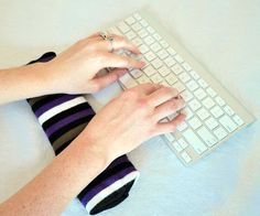 37 Unusual Uses for Lonely Socks | #21 - make a wrist wrest for your keyboard.