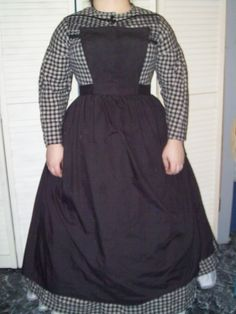 Victorian dress with apron.  Black and white plaid with black trims.  Made with Simplicity pattern 3723.  Circa 1860-65.  Civil war costume.