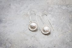sterling silver delicate earrings. a disc  by TamyZurTachshit