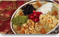traditional Turkish dessert: AŞURE Ingredients: wheat, beans, sugar, chickpeas, pomegranates, almonds, hazelnuts, peanuts, cinnamon, apricot, walnut ..