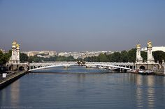The Pont Alexandre III is the most ornamented and most popular bridge in Paris. The beautiful bridge, designed by Résal and Alby at the end of the 19th century consist of a single 107m long span.