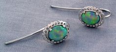 These crystal opal earrings were designed to match an existing ring a customer brought in. Cast in and set with two crystal opals, these earrings have a great play of color. Custom Earrings, Custom Jewelry Design, Opal Earrings, October Birth Stone, Opals, Sterling Silver Pendants, Birthstones, Turquoise Bracelet, Gemstone Rings