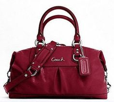I actually have two of these Coach bags, one in white/silver and the other is black. :)