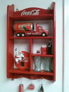 refinish an old ugly wooden curio shelf by painting it red, stenciling Coca Cola on it & displaying your Coke trinkets on it. Coca Cola Decor, Coca Cola Ad, Always Coca Cola, World Of Coca Cola, Coca Cola Bottles, Coca Cola Kitchen, Cocoa Cola, Vintage Coke, Vintage Signs