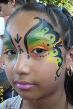 Full face paint butterfly eyes design