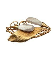 An Art Nouveau pearl and gold brooch, by Aimé Arnould, circa 1920.