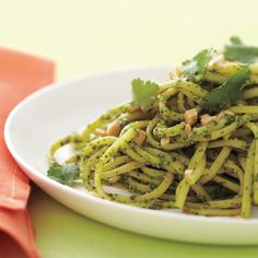 Cilantro can be polarizing, but many cooks around the world rely on it for the fresh, citrusy element it adds to an array of dishes -- like this pasta dish with Southeast Asian flair. Plant based protein, fairly low sodium for a serving. see comments Quick Pasta Recipes, Chicken Rice Recipes, Pesto Pasta Recipes, Bacon Pasta, Pesto Recipe, Healthy Recipes, Pesto Sauce, Soy Sauce, Veggie Recipes