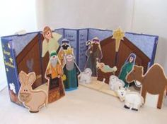 Nativity Tote & Play Embroidery Designs- I wonder if I can do this like the three ring binder doll house?