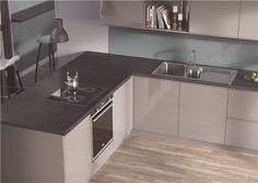EGGER Kitchen Worktops: F081 ST82 Pegasus Anthracite A subtly speckled stone effect, this worktop provides a dark but neutral base with which to combine other elements of your kitchen. Doors: U702 ST30 Cashmere Gloss