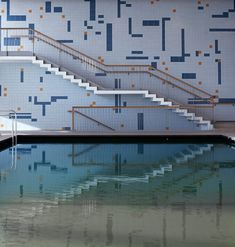 """In the main indoor pool, the studio collaborated with Stuttgart artist Matthias Kohlmann to create a """"graphically designed tiled wall"""", which references a previous design in the building. Natural Swimming Pools, Outdoor Swimming Pool, Swimming Pool Designs, Sauna, Rooftop, Facade, Stairs, Indoor, Cool Stuff"""
