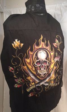 "Ed Hardy Long Sleeve Shirt; Size XXL. Black with Skull and Fire design on back. Button Front. 100% Cotton  Back features printed design with metal pieces; embroidered name. Front features small design with ""Ed Hardy"" name also embroidered."