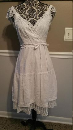Very pretty Cotton Eyelet and Lace Sundress. Perfect for Easter, Bridal Shower, Cruise Wear or just when you want that ultra feminine look.  Bust: 34 inches Waist: 28 inches Hips: 36 inches Skirt length from Waistline: 24 inches   Please ask as many questions as needed before purchase, as clothing is non refundble