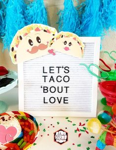 Let's Taco Bout Love in Words on a Felt Menu Board with Mr and Mrs Taco from a Taco Bout Love Valentine Taco Party | Mandy's Party Printables #valentineparty #tacoparty #tacoboutlove #ilovetacos #MPP #fiesta