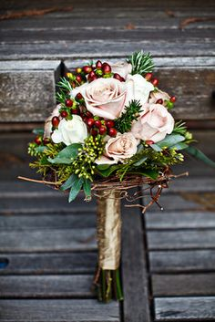 Cozy, Rustic, Christmas Wedding - maybe with ivory roses instead of blush, Sar?  At any rate, I love the inclusion of the holly berries...